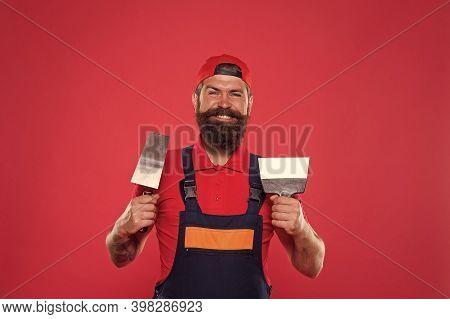 Professional Plasterer. Skillful Plasterer. Successful Renovation. Repair Success. Bearded Man Worke