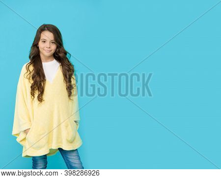 Comfy Style. Kid Wearing Soft Poncho. Wellbeing Concept. Little Girl With Long Hair. Happy Childhood