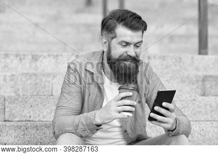Got Sms Online. Happy Man Read Sms Drinking Coffee Outdoors. Sending And Receiving Sms Via Smartphon