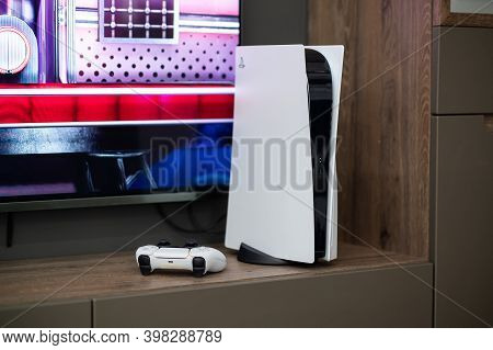 The Brand New Sony Playstation 5 Gaming Console With Dualsense Controller Near Tv Screen At Home Rea