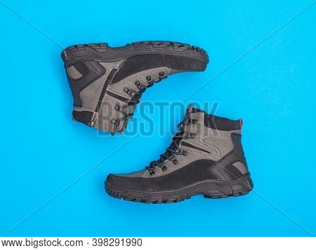 Stylish Mens Insulated Sneakers On A Blue Background. Mens Shoes For Cold Weather. Casual Sports Men