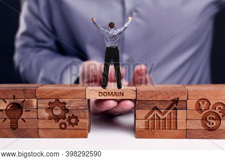 Business, Technology, Internet And Network Concept. Young Businessman Shows The Word:domain