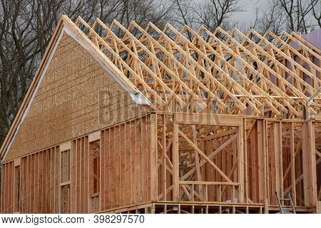 Installation Of Rafters And Walls Of A Plywood House Frame