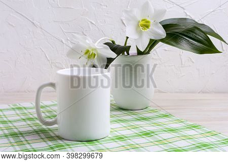 White Coffee Mug Mockup With Lily In Vase On Green Checkered Napkin.  Empty Mug Mock Up For Design P