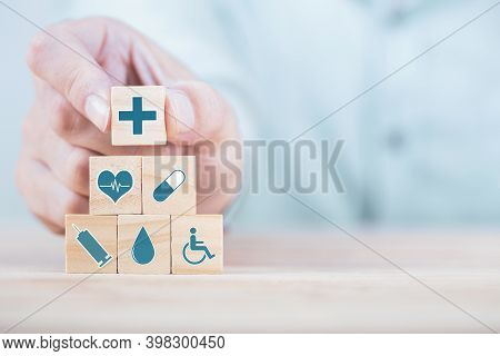 Businessman Chooses A Emoticon Icons Healthcare Medical Symbol On Wooden Block , Healthcare And Medi