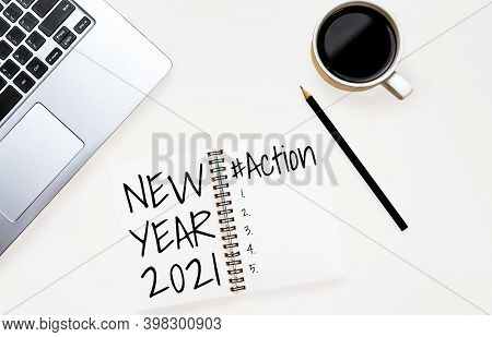 2021 Happy New Year Resolution Goal List - Business Office Desk With Notebook Written In Handwriting