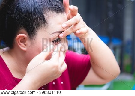 Woman Is Wearing Contact Lenses On Right Eye. She Uses Fingers To Cover Contact Lenses. The Edge Of