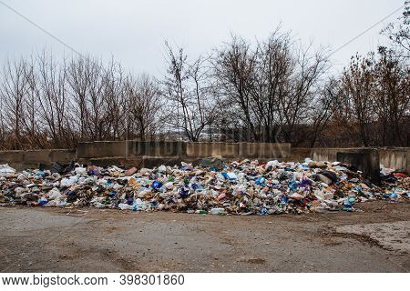 Dneprorudnoe, Ukraine January 29 2020:garbage Dump On The Grass Near The River. Ecological Catastrop