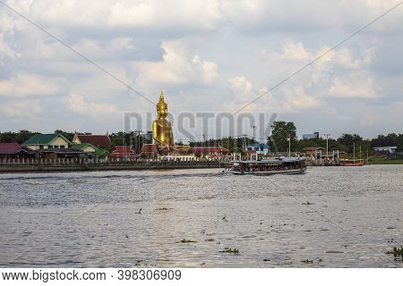 The Scenery Of The Big Golden Buddha And Passenger Ship By The Chao Phraya River In Nonthaburi Provi