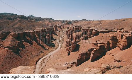 Grand Canyon Charyn. Rocks From Sedimentary Rocks. Huge Cracks In The Rocks. The Ground Is Red-orang