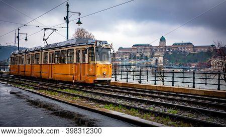 BUDAPEST, HUNGARY - January 29, 2015: Yellow tram in Budapest  rainy day