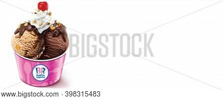 A Container Of Baskin Robbins Ice Cream In Chocolate Chip And Caramel Flavor On An Isolated Backgrou