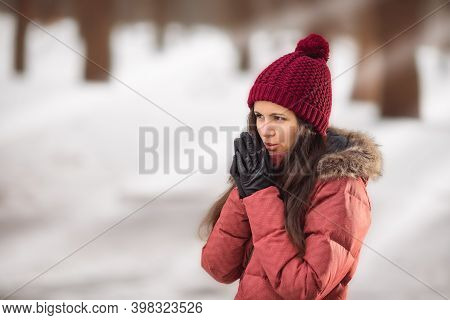 Winter Portrait Of A Woman In Red Hat. Christmas Time. Snowdrift, Cold. Happy New Year. Winter Holid