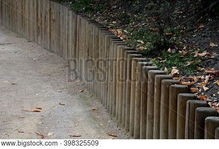 The Park Threshing Beige Gravel Roads In The Sloping Terrain Have On One Side A Wooden Palisade Reta