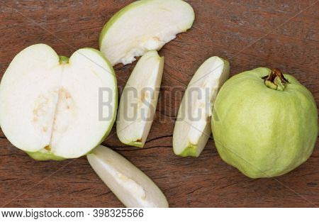 Top View Of Fresh Green Guava On Wooden Board