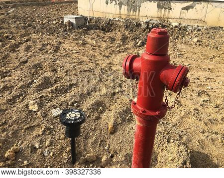 Red Fire Hydrant At Construction Site. Fireman Equipment