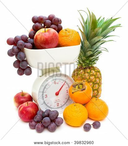 Scale And Fruits Isolated On White Background