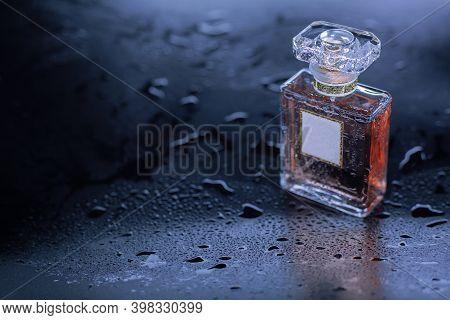 Female Perfume On S Gray Wet Background