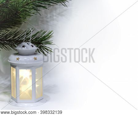 White Luminous Lantern With Stars And Green Pine Branches On The Left Of The Leaf Isolated On A Whit