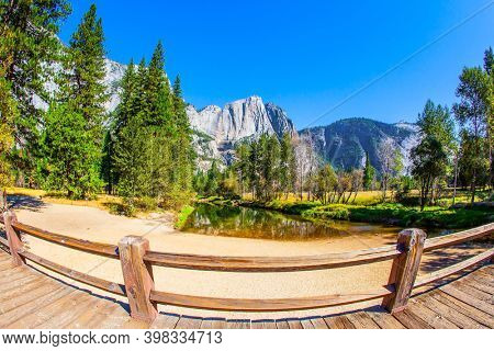 Sandy bottom of a shallow lake. Charming Yosemite Valley. Yosemite Park is located on the slopes of the Sierra Nevada. The rock-monolith El Capitan is reflected in the smooth water.