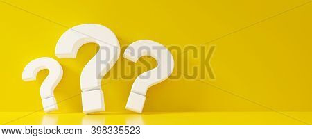 Three Yellow Question Mark Symbols Leaning Against Yellow Wall And Floor Room With Copy Space, Quest