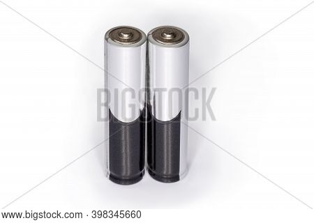 Alkaline Batteries Aaa Size Standing With The Positive Terminals Up On A White Background Close-up,