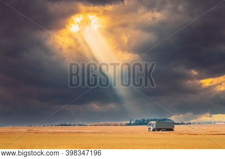 Truck, Tractor Unit, Prime Mover In Motion On Road Freeway. Motorway Highway On Sunset Sky Backgroun
