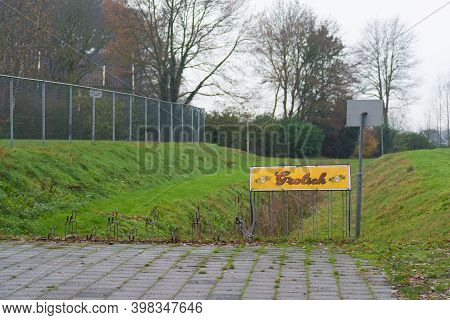Oldenzaal, Netherlands - December 6, 2020:  Empty Bicycle Parking Place On A Sports Park With A Grol