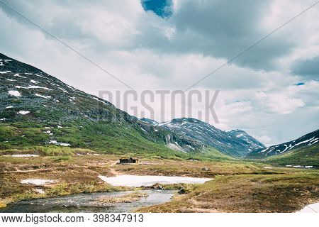 Reinheimen National Park, Norway. Mountains Landscape In Early Summer. Mountain Range In One Of The