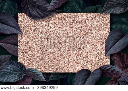 Glittery board on a metallic blue leaves textured background