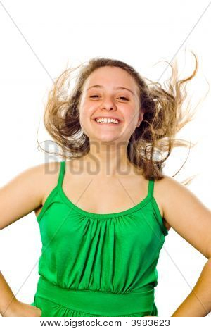 Girl Smiling With Her Hair Blowing
