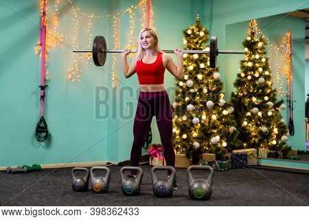 Christmas Fitness Woman Smiling Joyful And Happy. Beautiful Cheerful Caucasian Female Fitness Model