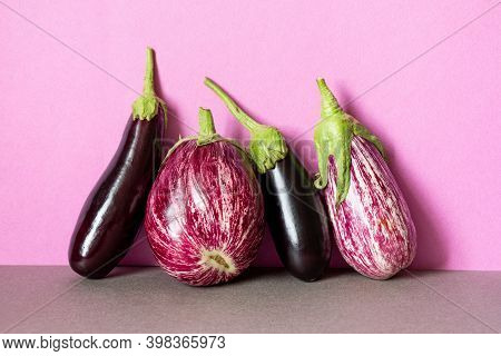 Still Life With Ripe Violet Aubergine On Purple Background. Different Types Of Eggplant With Unique
