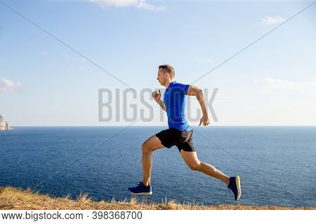 Man Athlete Runner Running Trail In Background Blue Sky And Sea