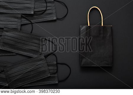 Shopping Paper Bag With Black Medical Face Masks. Shopping, Food Delivery In Covid 19 Lockdown Quara