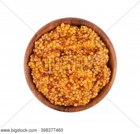 Grain Mustard Sauce In Wooden Bowl, Isolated On White Background. Mustard Beans. Top View.