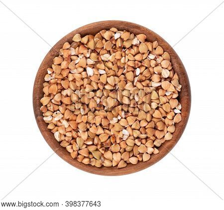 Buckwheat Groats In Wooden Bowl, Isolated On White Background. Green Buckwheat Seeds. Top View.
