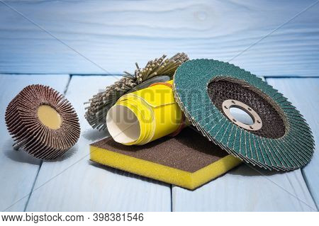 Abrasive Tools And Yellow Sandpaper On Blue Wooden Boards. These Tools Are Used To Grind Objects