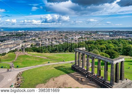 EDINBURGH,SCOTLAND - AUGUST 13,2019 : The National Monument of Scotland and a panoramic view of the city of Edinburgh
