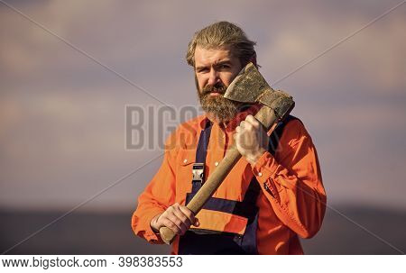 Hard Labour. Brutal Bearded Man Axe In Hands. Brutal And Bearded. Builder With Axe. Use Axe Construc