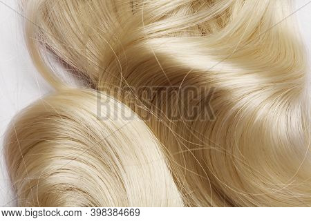 long blond hair as background. human hair detail. long blond hair as background. texture