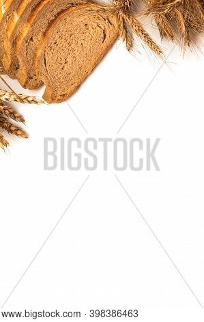 Whole Wheat Bread. Fresh Loaf Of Rustic Traditional Bread With Wheat Grain Ear Or Spike Plant Isolat