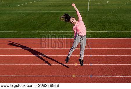 Happy Winner. Runner On Competition Celebrate Success. Sprinter Won On Stadium Gym. Winner. Child At