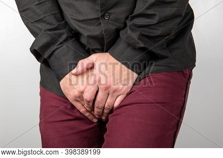 Urinary And Prostate Problems In Men. Male Holding Intimate Parts