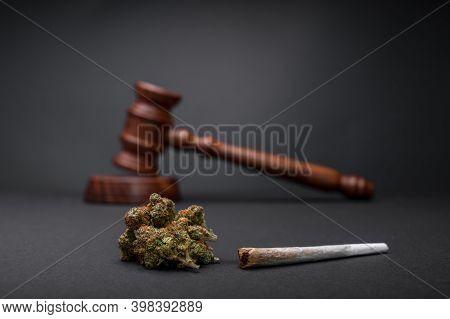 New Law - Legalize Marijuana. Wooden Judge Hammer. Cannabis Legalization As Medical Drug. Cbd Healin