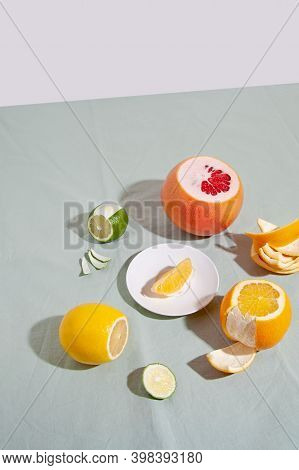 Fruit Citrus With Peels On Green Background. Concept Reducing Food Waste