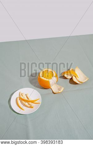 Fruit Orange Citrus With Peels On Green Background. Concept Reducing Food Waste