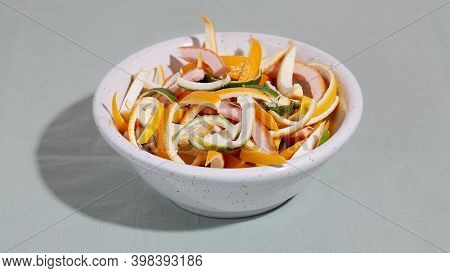 Sliced Citrus Fruit Peel For Cooking Candied On White Plate. Concept Reducing Food Waste