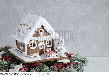 Delicious Gingerbread House And Christmas Wreath. Christmas Baked Goods. New Year. Copy Space.