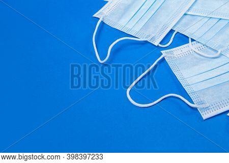 Blue Medical Face Masks On Blue Background